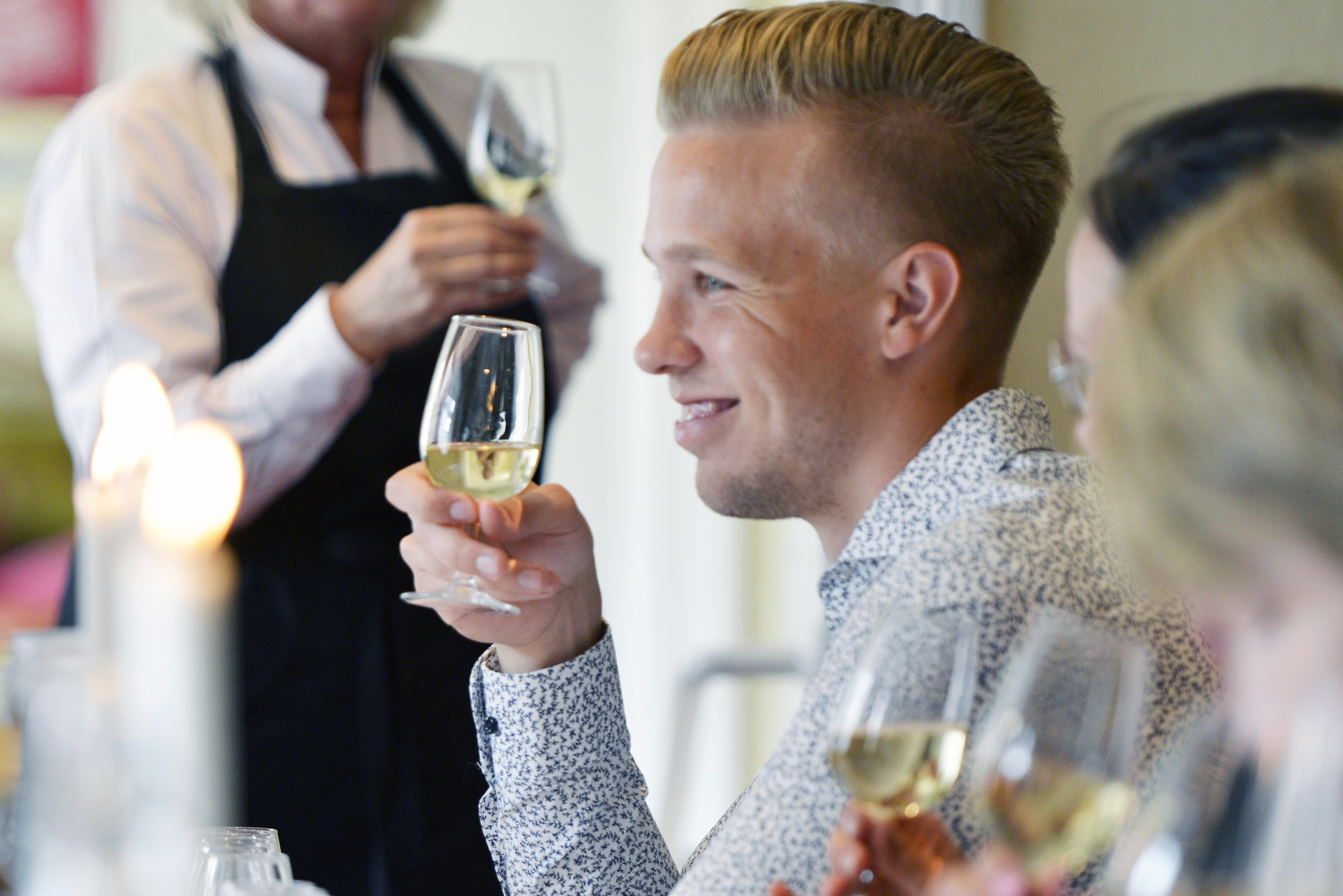 Stockholm Wine Tasting with a happy man trying out white wine